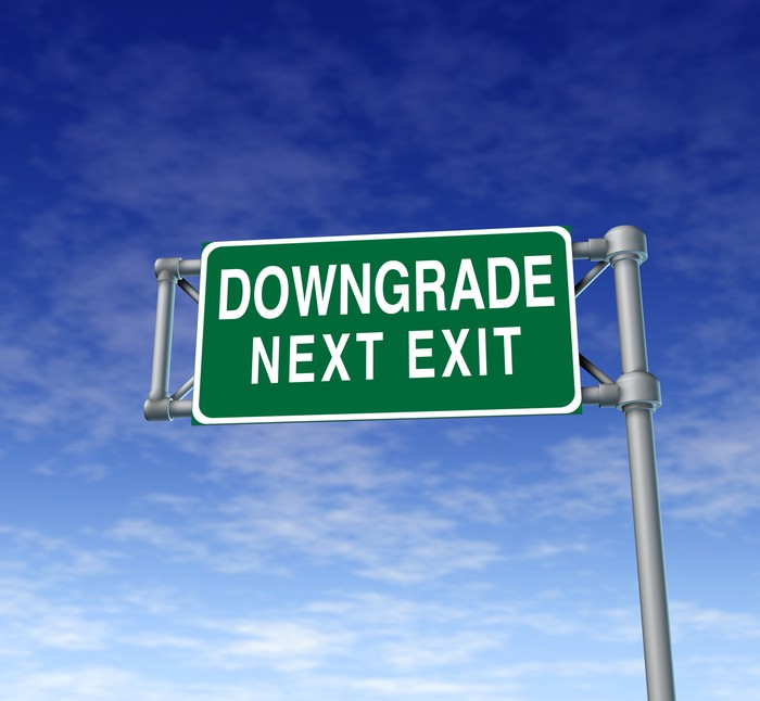 "Sign reading ""Downgrade next exit"""