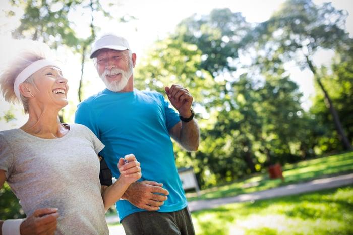 Older couple running outside