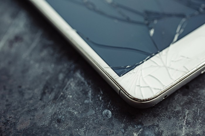 A smartphone with a cracked screen.