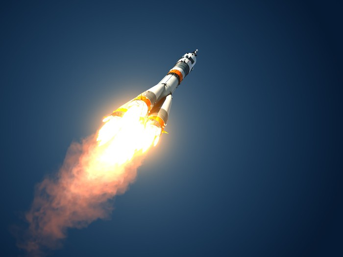 A rocket soars into space.