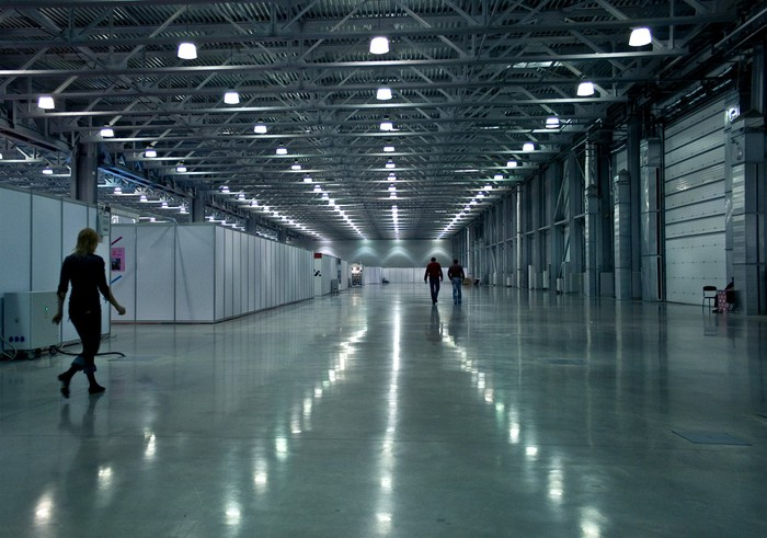 The brightly-lit interior of a modern industrial warehouse space.