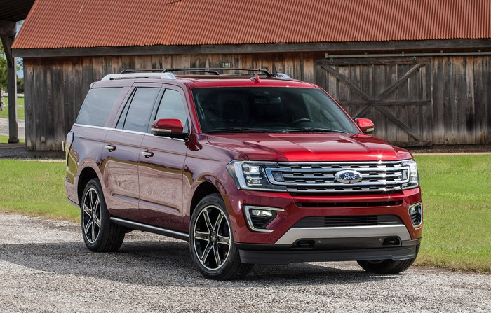 A red Ford Expedition, a full-size truck-based SUV.