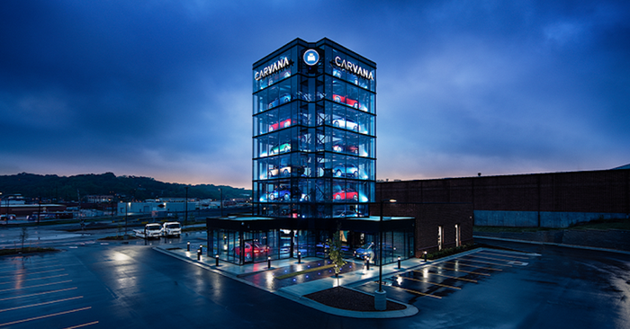 A Carvana car-vending tower at night.