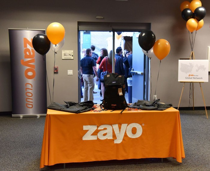 Zayo employees at a company event.