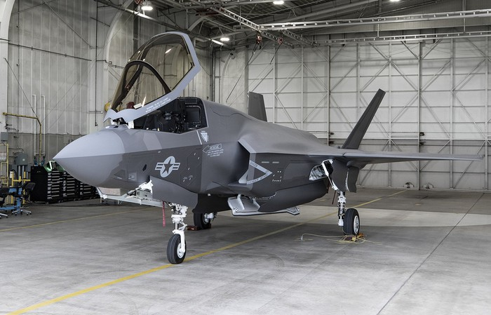 A Lockheed Martin F-35 fighter jet parked in a hanger.