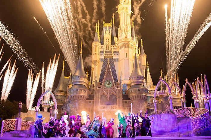 Fireworks over the Magic Kingdom's castle during a Halloween-themed show.