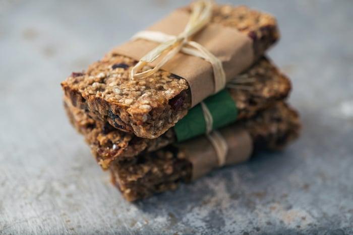 A stack of three healthy granola bars.