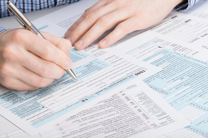Man filling out tax forms