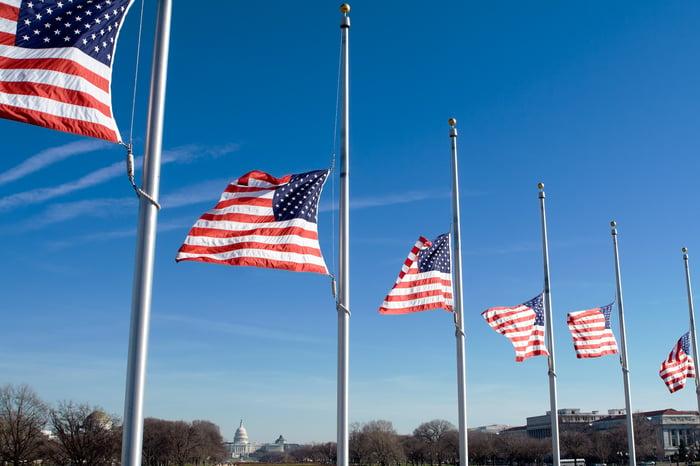Six American flags at half mast