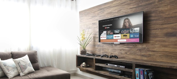 An Amazon Fire TV mounted on a living room wall.