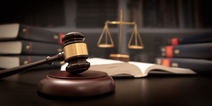 Gavel and scales of justice on a desk.