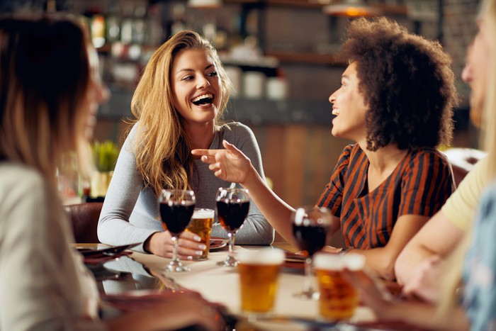 Women smiling drinking wine