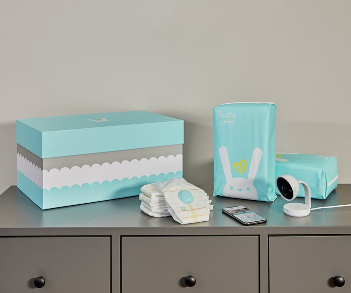 The Lumi by Pampers system with monitor, diapers, etc. arranged on a dresser