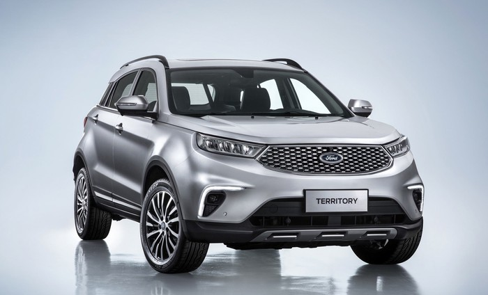 A silver Ford Territory, a sleek compact crossover SUV.