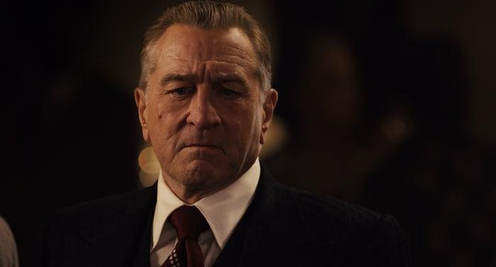 Robert De Niro wearing a suit and tie.