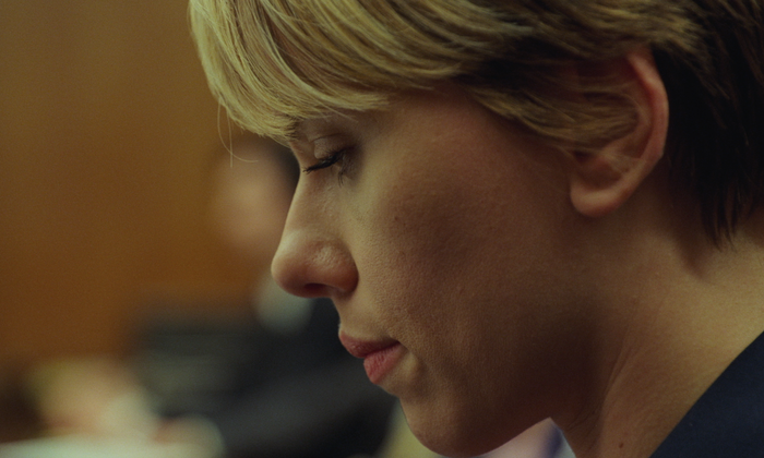 A close-up of Scarlett Johansson with a despondent look on her face.