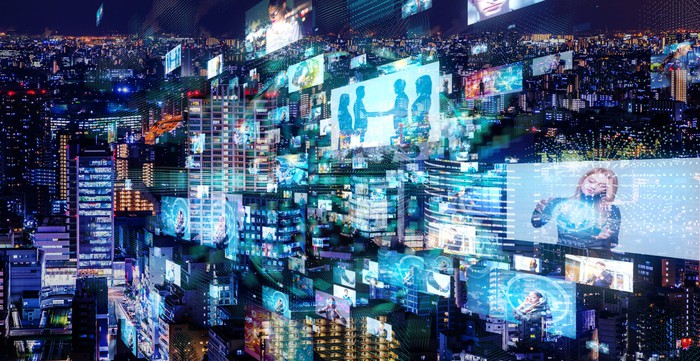 a city at night overlayed with high-tech images of people.jpg