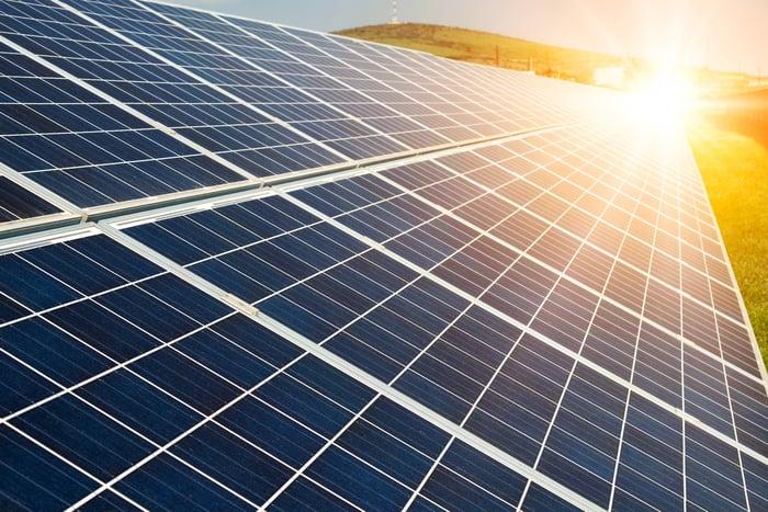 Photo-voltaic solar panels at sunrise.