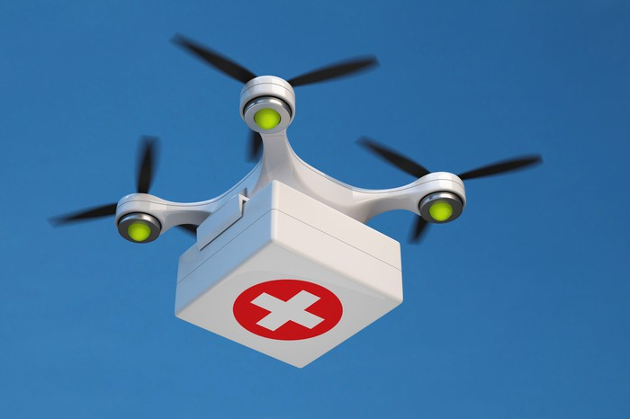 A drone delivering a first-aid kit.