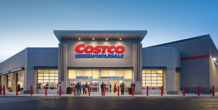 Photo of a Costco warehouse from the outside, featuring the company logo in large red and blue letters.