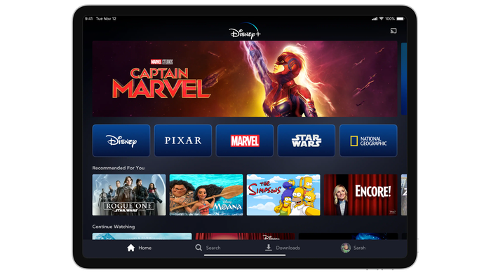 The Disney+ home page featuring Captain Marvel show on a tablet.