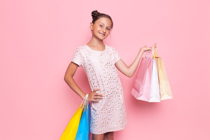Tween girl with shopping bags