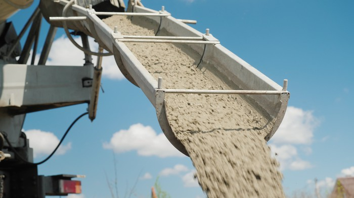 Concrete being poured at a construction site.