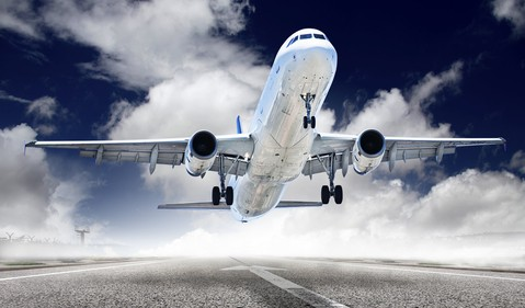 Airplane Taking Off From Runway Dramatic Angle