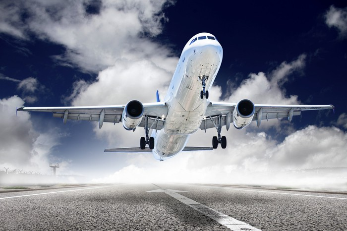 An airplane takes off from a runway.