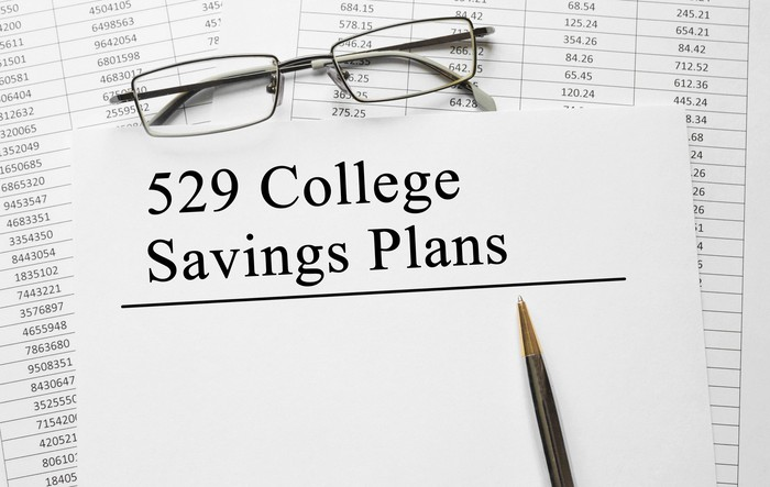 Cover of 529 savings plan with pen resting on it