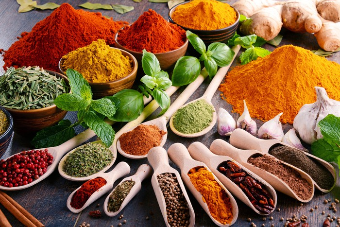 A number of different and colorful spices and herbs.