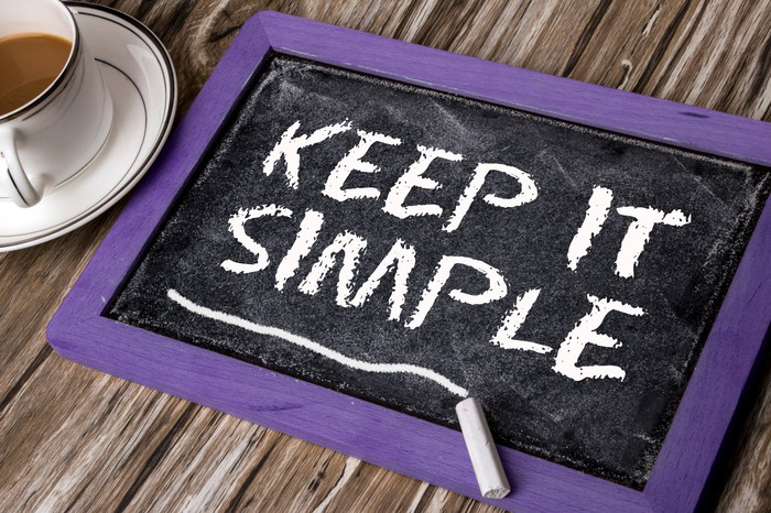 """Chalk tablet with """"Keep it simple"""" written on it"""