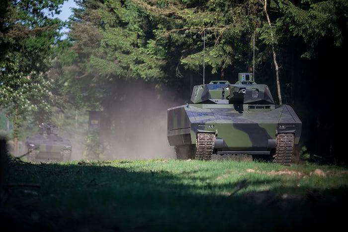 The Rheinmetall Lynx on maneuvers in a forest setting.
