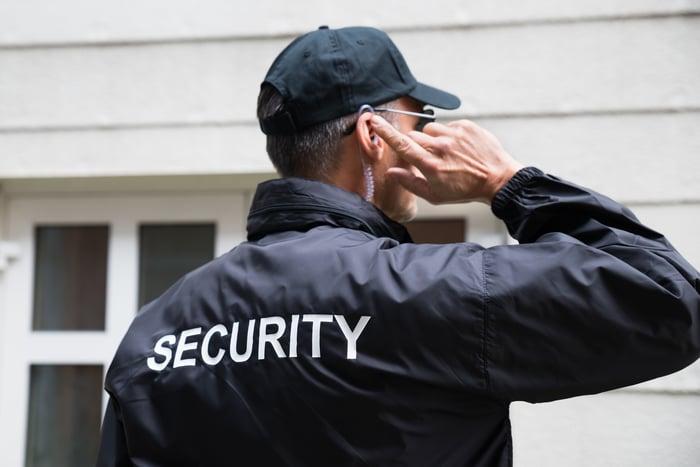 Security guard using earpiece.