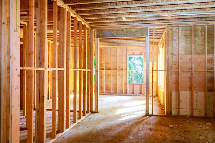 The interior framing inside of a new construction home being built.
