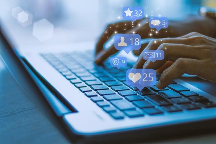 A laptop user access a social network.