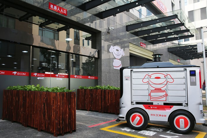 A JD autonomous delivery vehicle at a delivery station in Changsha, China.