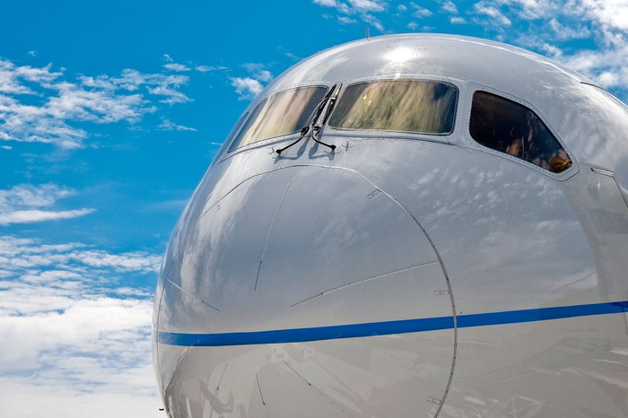 Close up of the nose of a Boeing 787 Dreamliner commercial jet airliner.