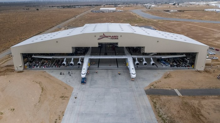 Stratolaunch's Roc superplane emerging from a hangar