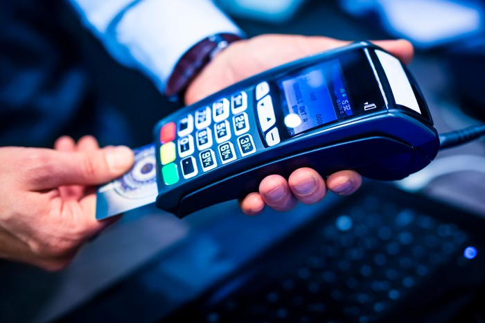 A hand-held credit card processing machine.