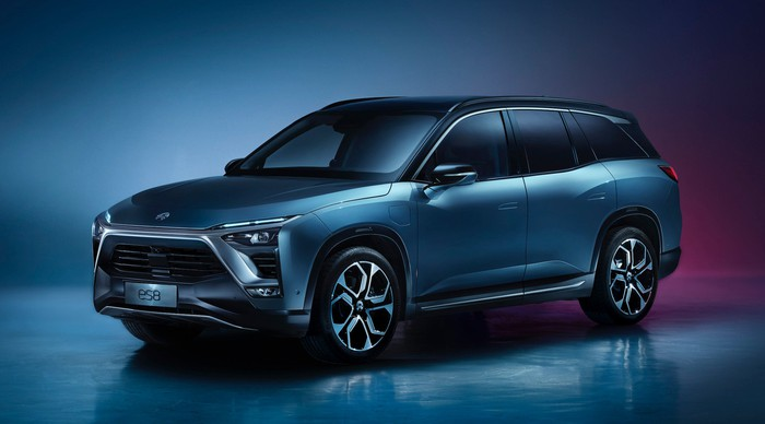 A blue NIO ES8, an upscale 7-passenger electric crossover SUV.
