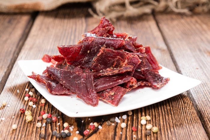 Pile of beef jerky on a square dish