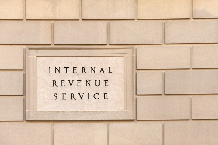 Wall with engraved plaque reading Internal Revenue Service.
