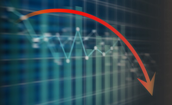 Red recession arrow pointing down on a stock market screen.