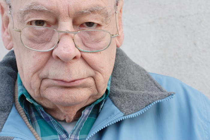 A close-up photo of an older man's face, and he looks annoyed.