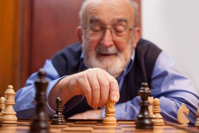 An older man playing a game of chess