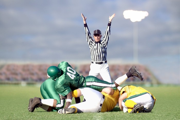 Referee signaling touchdown