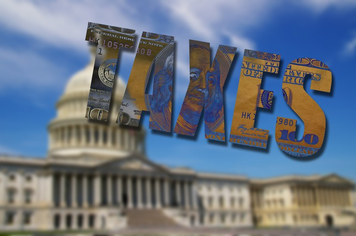 U.S. Capitol Building with word TAXES superimposed