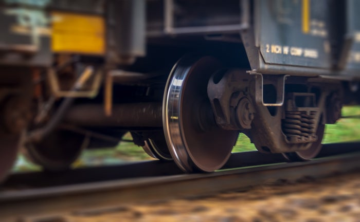 Close-up of a freight train's wheels as it glides along the rails.