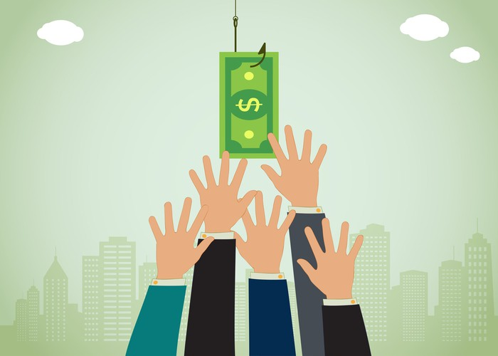 Hands reaching for money on a hook.